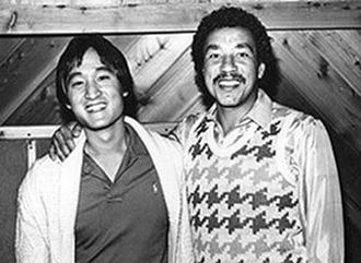Dale Kawashima with Smokey Robinson.
