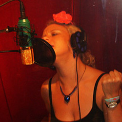 Luella recording vocals in the studio.